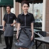 waitress black shirt gray apron
